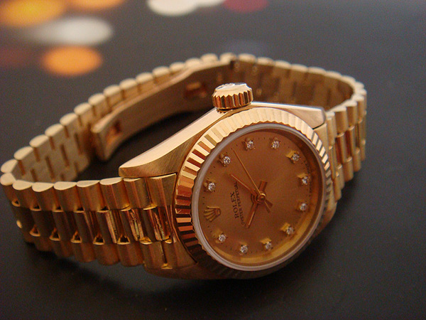 Ladies Rolex Oyster Perpetual 18K Diamond Dial Ref 67198
